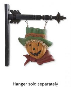 Scarecrow with scarf and hat