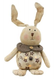 Tan plush bunny with bell